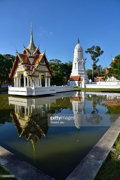 Ayutthaya, Thailand: Wat Kasat Thirat temple and Prang with reflection on pool.