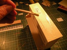 "Miniature Piano workshop. Step no.17.  put some glue on ""top 1"""