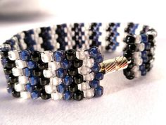 Hey, I found this really awesome Etsy listing at https://www.etsy.com/il-en/listing/89217908/blue-black-and-white-peyote-stitch