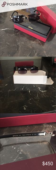 Cartier glasses - buffalo 100% authentic white \black buffalo horn C Decor sunglasses.they come in the red Cartier box,black hard Cartier case and book.Grey lenses Dimensions: lenses 57mm, bride 18mm, and temples 140 Accessories Sunglasses