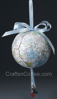 Map Crafts: Around-the-world map ornament. Mod Podge, old maps & a STYROFOAM ball are all you need. Fun way to commemorate a special trip, and a great gift idea. note the travel-theme charms Christmas Tree Inspiration, Christmas Tree Themes, Noel Christmas, Diy Christmas Ornaments, Christmas Balls, All Things Christmas, Holiday Crafts, Homemade Christmas, Christmas Ideas