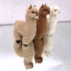 Sweet, soft and simply alpaca. These intricate, hand made critters make charming and unique gifts or keep for yourself. Each animal is custom-made with the finest, high quality craftsmanship. Made with 100% pure baby alpaca fleece to keep sensitive skin safe and happy.