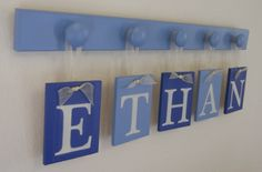 Baby Boy Nursery Decor Name Sign Set Includes Personalized Alphabet Wall letters and 5 Wooden Pegs Blue and Light Blue. Custom Order ETHAN. $25.00, via Etsy.