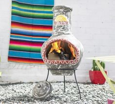 Clay chimenea in a Mexican style with El Sol written on the funnel. This chimenea comes with a rain lid for use when the chimenea is cool.These chimeneas are hand made and hand painted and therefore each are unique so some colours and patterns may vary slightly.Only small fires are needed in these chimeneas as they are so efficient, once warm clay will retain the heat for a long while.We recommend covering your chimenea when not in use to prolong the life.