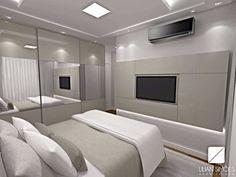 Suíte casal com armário em portas de espelho que ampliam visualmente o ambiente
