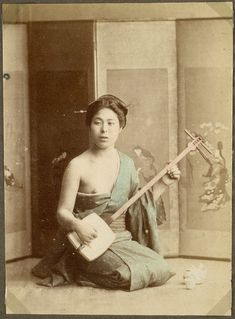 Woman playing an instrument | by National Museum of Denmark