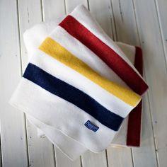 Revival Stripe Bone White wool throw folded on floor