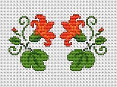 Symmetric floral motif in bright colors:orange,tangerine,green.