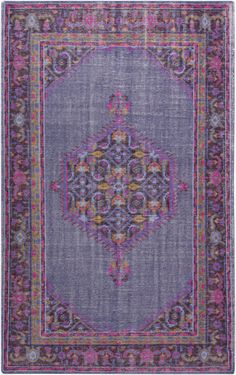 Hand knotted wool rug looks regal with a traditional pattern in shades of mauve, magenta, hot pink, and iris. From the Zahra Collection by Surya. (ZHA-4001)