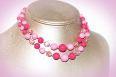 Vibrant pink glass beaded necklace. Two strands of gorgeous chunky round glass beads. One of many vintage necklaces from my Mom's Vintage Jewelry Collection!