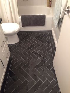 Charcoal Gray Herringbone, Honed Marble Floors in the Bathroom. www.houseandleisure.co.za loves this jack and Jill