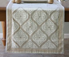 Elegant white and gold table runner