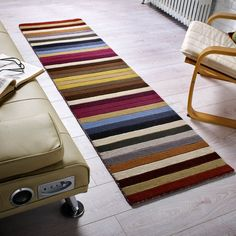 Poplar Hallway Runners are part of the Woodland collection. This multi coloured striped design is handmade with a luxurious Wool pile that is deep and soft. Hall Runner Rugs, Hallway Runner, Hallway Inspiration, Rug Store, Striped Rug, Rugs Online, Modern Rugs, Stripes Design, Carpet Runner