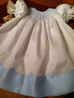 Hand Smocked Cream/Blue Sateen Batiste Bishop Heirloom  Dress size 12 months. Bloomers extra charge. $125.00, via Etsy.