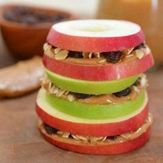 Healthy snack sandwiches! Apples, peanut butter, raisins and oats. Not only tasty but aesthetically pleasing!