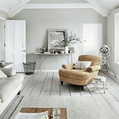 Whitewashed living room As a place to chill out, this room is hard to beat. The understated coastal atmosphere - created by the grey and white-painted flooring, open beams and deep linen-covered armchair - makes it ideal for quiet contemplation.