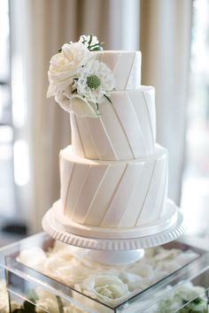 All White Wedding Cake - Almost Too Pretty To Eat via Style Me Pretty