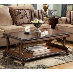 Table de cocktail rectangulaire Shelton Shelton Rectangular Cocktail Table Signature Design in Coffee and Cocktail Tables. The flowing traditional design of the Shelton accent table collection features a rich finish and beautiful details to create a warm Furniture, Traditional Sofa, Sofa End Tables, Home Decor, Sofa Table Decor, Sofa Table, Coffee Table, Living Room Table, Traditional Coffee Table