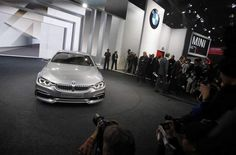 BMW introduces the BMW 4-series coupe concept during the BMW press conference at the 2013 North American International Auto Show at Cobo Center on Monday, Jan. 14, 2013 in Detroit.