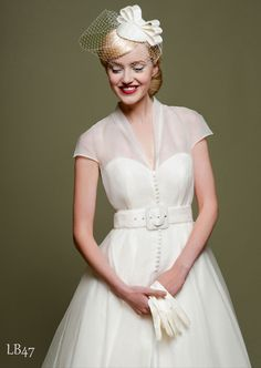 A vintage 1950s wedding dress and hat...I'll be damned, this is really cute!
