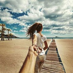 Follow Me To by Murad Osmann. Photographer Murad Osmann creatively documents his travels around the world with his girlfriend leading the way in his ongoing series known as Follow Me To. Chronicling his adventures on Instagram, the Russian photographer composes each shot in a similar fashion. We see each landscape from the photographer's point of view with his extended hand holding onto his girlfriend's in front of him. #FollowMeTo   #MuradOsmann   #Russianphotographer  