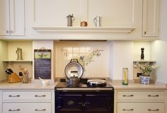 Charlie Kingham No. 32 Kitchen | Bespoke Shaker Style Cabinets and traditional Kitchens and Interior Design Ideas. AGA Range Cooker, Hand painted Cupboards and Home Decor Fired Earth Tiles