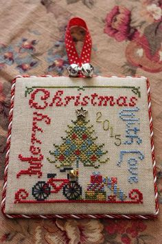 """Merry Christmas With Love"" by Tempting Tangles Designs, 2015 JCS Christmas Ornament Holiday Issue, Lambswool Linen Small Cross Stitch, Just Cross Stitch, Cross Stitch Finishing, Beaded Cross Stitch, Cross Stitch Charts, Cross Stitch Embroidery, Cross Stitch Patterns, Loom Patterns, Cross Stitch Christmas Ornaments"