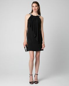 Knit Halter Cocktail Dress - An asymmetrical panel drapes from the halter neckline along the bodice of a knit cocktail dress for an ethereal look.