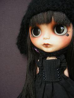 Doll in black