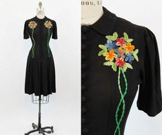 Adorable 1930s / 1940s day dress! Done in a black rayon crepe. With sweet starfish embroidery on the bodice that are done in chenille loops and