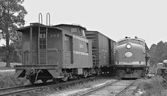 AR, Aberdeen, North Carolina, 1961 Aberdeen and Rockfish Railroad mixed train pulls into yard at Aberdeen, North Carolina, after its daily run while F3 locomotive awaits clear track to shop in April 1961. No. 303 is both a caboose and a combined baggage-passenger car. Photograph by J. Parker Lamb, © 2016, Center for Railroad Photography and Art. Lamb-01-094-02