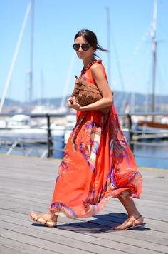 This dress is amazing! Love this look with the long skirt, cut away shoulders and great bright colors. Relaxed but elegant...