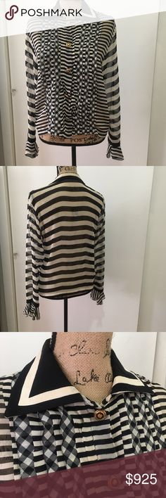 *RARE* Vintage Gianni Versace Couture Blouse Beautiful brand new condition worn once! Comes from a smoke free home, perfect for fall 2017! WILL NOT LAST! Super Couture and High Fashion one of my favorite Versace Blouses the fit is absolutely beautiful, im particular and only selling to a good home! for Fashionistas & Style Collectors ONLY! Versace Collection Tops Blouses