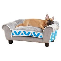 """Ideal for lazy afternoons and evenings around the fireplace, this chic pet bed offers your four-legged companion a cozy resting spot while its chevron motif adds classic style to your decor.    Product: Pet bedConstruction Material: Wood and foamColor: Blue and grayFeatures:  Fits pets up to 10 lbsRemovable cushion coverDimensions: 12"""" H x 29"""" W x 16"""" DCleaning and Care: Spot clean with water"""