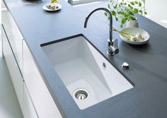 Have you seen Duravit Kitchen Sinks lately? New kitchen sinks from Duravit come  in a large scale with the sink and drain area in almost equal proportion. The Kiora, available in white, pergamon, c…