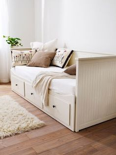 I love this daybed. It has drawers, functions as a couch or twin bed, and pulls out into a queen bed.