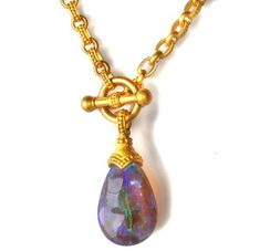 LOVIN this necklace of my birthstone. This is a 40 carat lavender~blue crystal OPAL with 22K gold pendant necklace made in Lighting Ridge, Australia!!!! <3