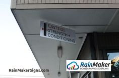 Bellevue-WA-gym-hanging-sign-rainmaker-signs.jpg