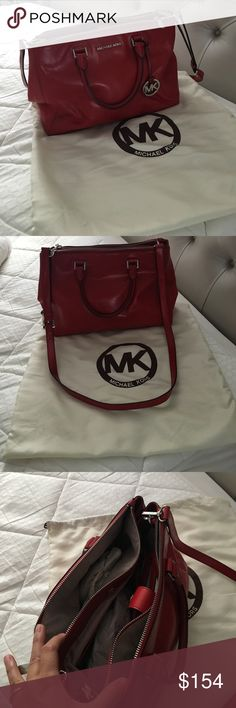 Michale Kors red handbag Michael Kors beautiful red handbag. Pre owned may show some signs of wear. So many compartments. Two zipper and the middle clip closure. Took very good care always in dust bag. Authentic. Hand held or use the long strap up to you.