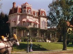 "The house from ""Meet Me in St. Louis."" I LOVE the red and white awnings. In the winter scenes, they take the awnings down. Such a great movie."