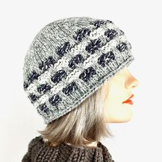 """This unisex hat fits her like a cloche. It is a top-down hat knit with three colors of yarn and the addition of some reflective fiber in the basketweave section. It glows in the dark and is shown here on a head 22"""" head model. I designed this to also work as a beanie for a guy. Basket Weaving, Knitted Hats, My Design, Fiber, Guy, Beanie, Challenges, Unisex, Knitting"""