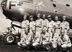 WWII crew with their plane plus nose art !