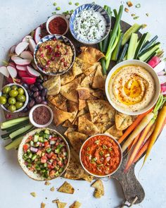 Middle Eastern Inspired Layer Dip with Hummus, Muhammara, Baba Ganoush, Herbed Labneh and Shirazi Salad recipe by Molly Adams Shirazi Salad, Salad Recipes, Vegan Recipes, Meze Recipes, Fingers Food, Baba Ganoush, Layer Dip, Layer Salad, Eastern Cuisine