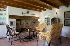Love the yellow chairs with the old fireplace