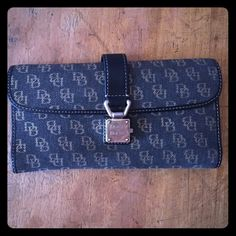 Dooney and Bourke wallet! Great condition! This is a great wallet- functional, classically stylish, and good quality. Perfect condition! Dooney & Bourke Bags Wallets