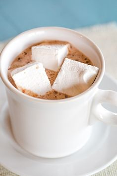 Homemade Marshmallows are easy and a million times better than the store-bought ones! Perfect for hot chocolate, s'mores and holiday gift-giving!