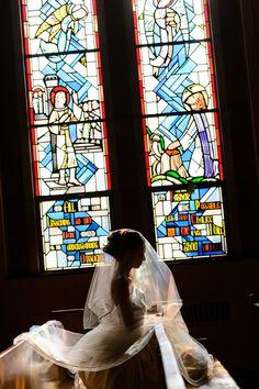 Beautiful photo of the bride in church, photos by Susan Stripling Photography via junebugweddings.com