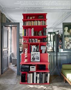 a chic red bookcase is everything. via elle decor march