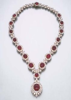 A FINE RUBY AND DIAMOND PENDANT NECKLACE, BY HARRY WINSTON Designed as graduated cabochon ruby and circular-cut diamond clusters, with trefoil spacers, suspending a detachable cabochon ruby and diamond cluster pendant, 40.0 cm. Signed Winston for Harry Winston