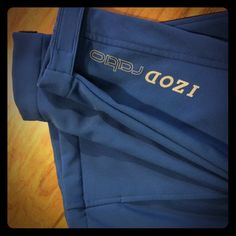 IZOD PERFORM X Royal Blue trimmed in black. Awesome material large pockets for hands along with a zippered chest pocket. As you can see in the pictures the bands at the wrists are adjustable with Velcro.   Very nice piece! IZOD Jackets & Coats